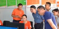 全国总社办公厅副主任程庆新在荆州调研时鼓励县供销社大胆探索改革路径 - 供销合作总社