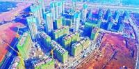 航拍军运会运动员村,目前30栋建筑17栋主体结构已封顶,计划春节前所有建筑主体结构全部封顶 记者任勇 摄 - 新浪湖北