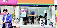 图为武昌徐东一家中介公司门点有点冷清 楚天都市报记者李辉摄 - 新浪湖北