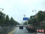 7月21日武汉出梅,当日上午部分区域仍有零星降雨 张芹 摄 - 新浪湖北